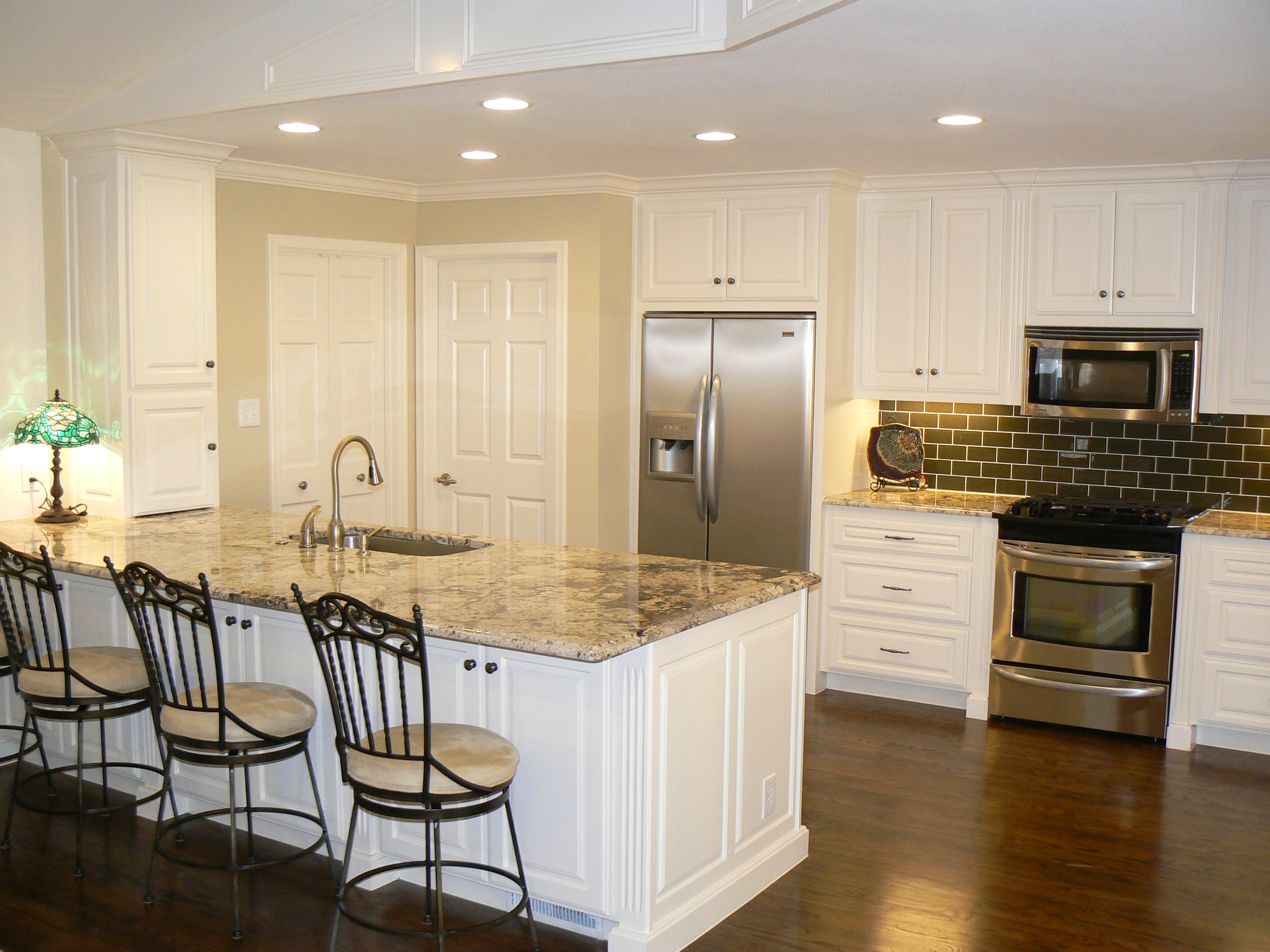 Pics of light white kitchen cabinets w hardwood floors for Floor kitchen cabinets