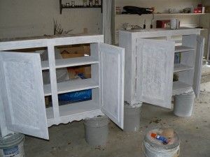 primed cabinets on paint cans